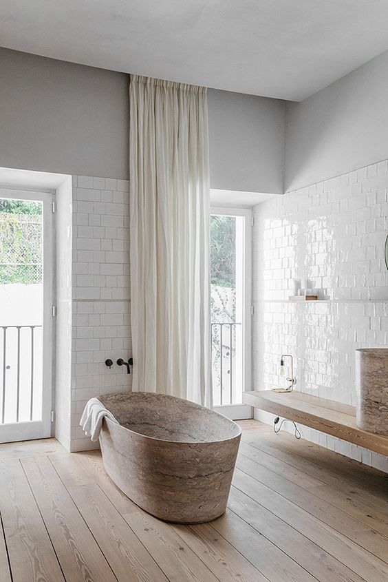 Curtains are welcome in different spaces including bathrooms, they add a cozy feel