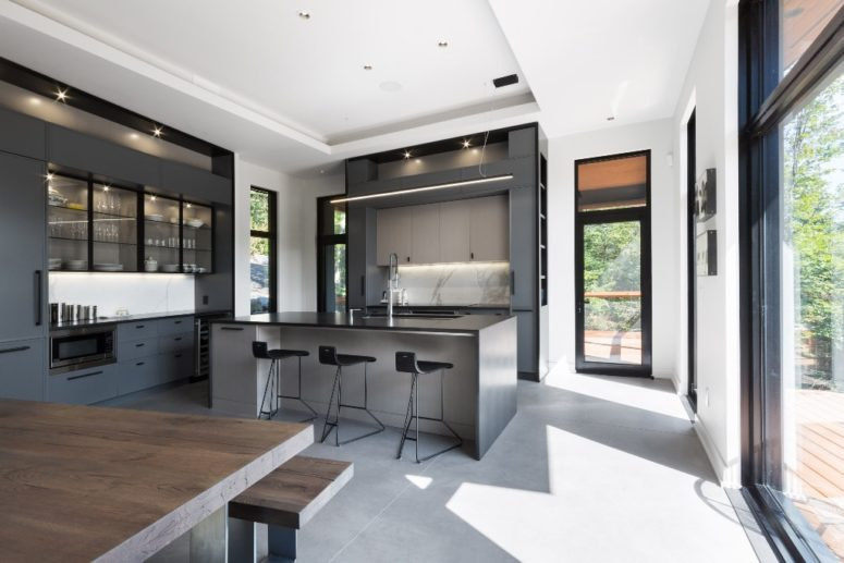 The interiors are minimalist, done with metal, concrete, plywood, in grey, black and white