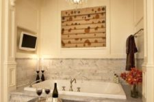 04 a chic and romantic niche with a bathtub clad with grey marble tiles and a backsplash covered with them, too