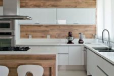 04 a glossy minimalist kitchen in white and rich-colored wood for a more natural feel