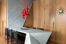 04 a sculptural concrete kitchen island and dining table that is extended to the wall makes a statement