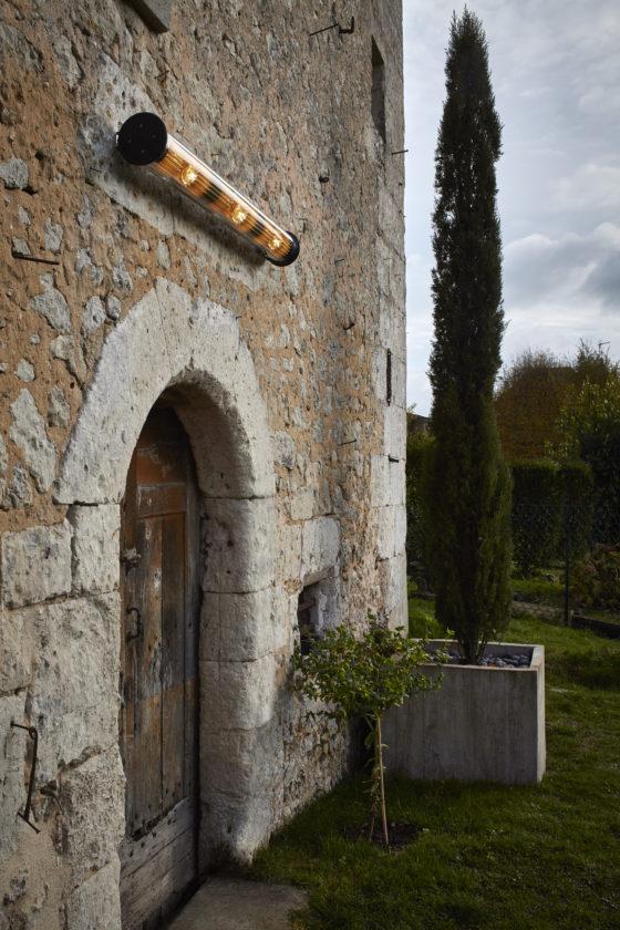 A single Wing light over an antique backyard entrance door