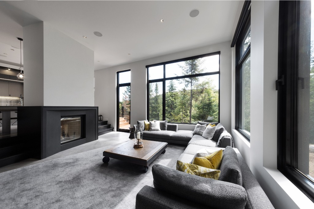 The two sided fireplace adds coziness, and a large corner sofa create a nice conversation pit