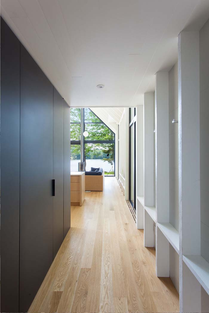 The walls features comfortable shelves, and there are wardrobes lining up the corridor