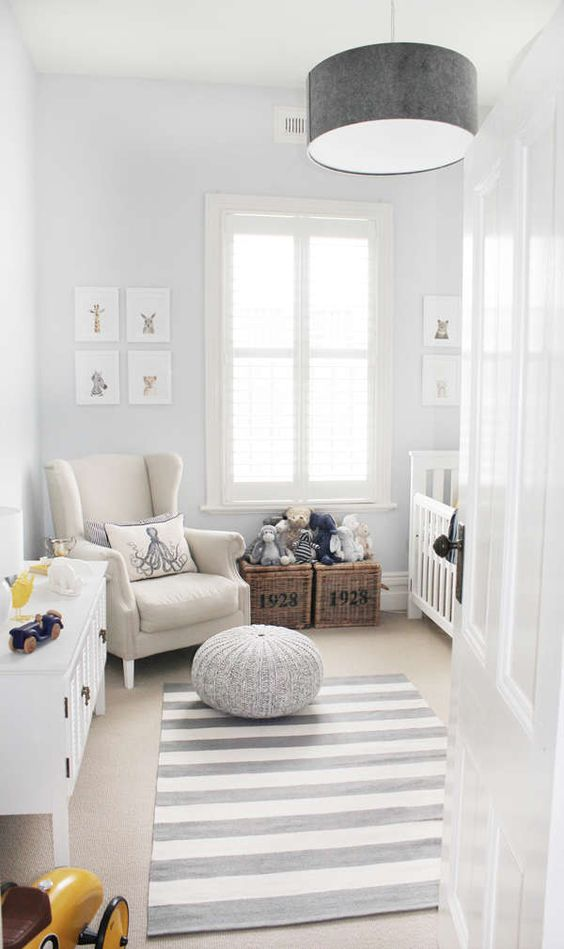 a striped rug doesn't dominate the space, and all the rest is off-white, which is perfect