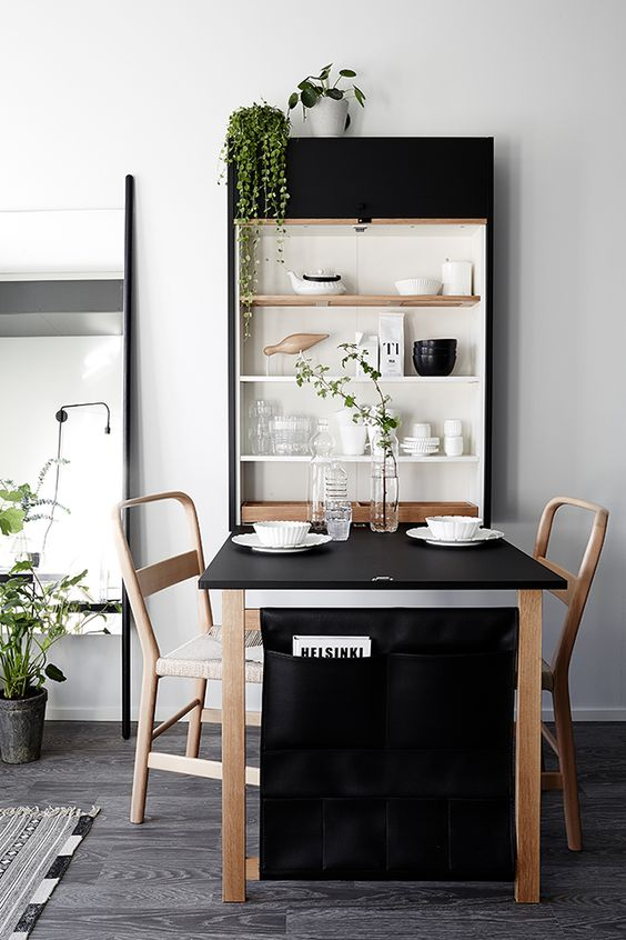 a wall shelving unit with a clesed part perfectly matches the dining set and adds to the decor