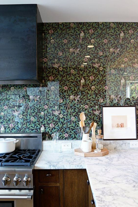 cover the wallpaper with acrylic or glass screens to save the wallpaper from grease and water splashes