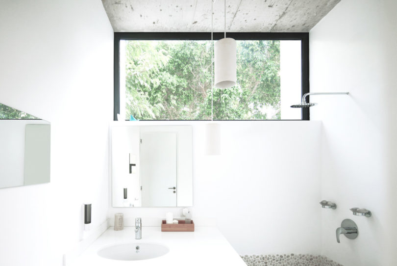 A tiny bathroom has everything necessary, and there's a window to fill it with light and fresh air