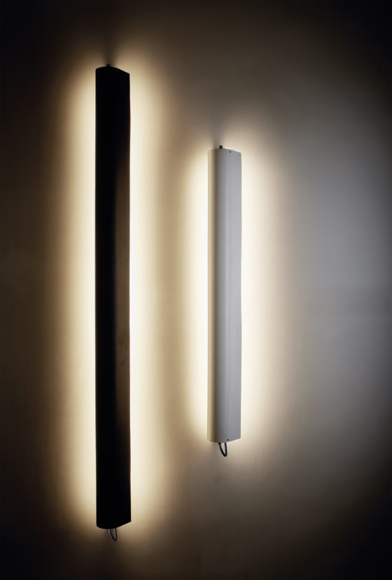 Flap lamps are available in various sizes and in classic black and white