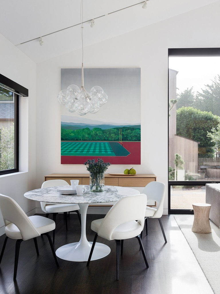 Here's an indoor dining zone with a bold artwork and a marble round table to catch an eye
