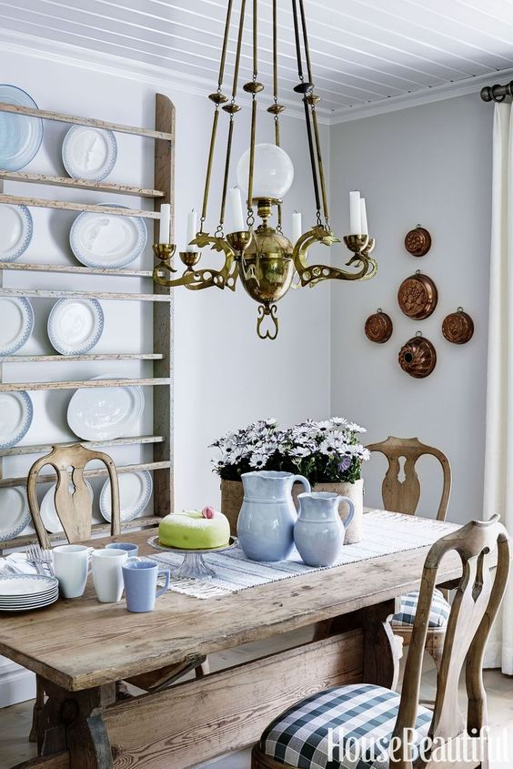 a a French country chic kitchen with ethereal shelves for plate display