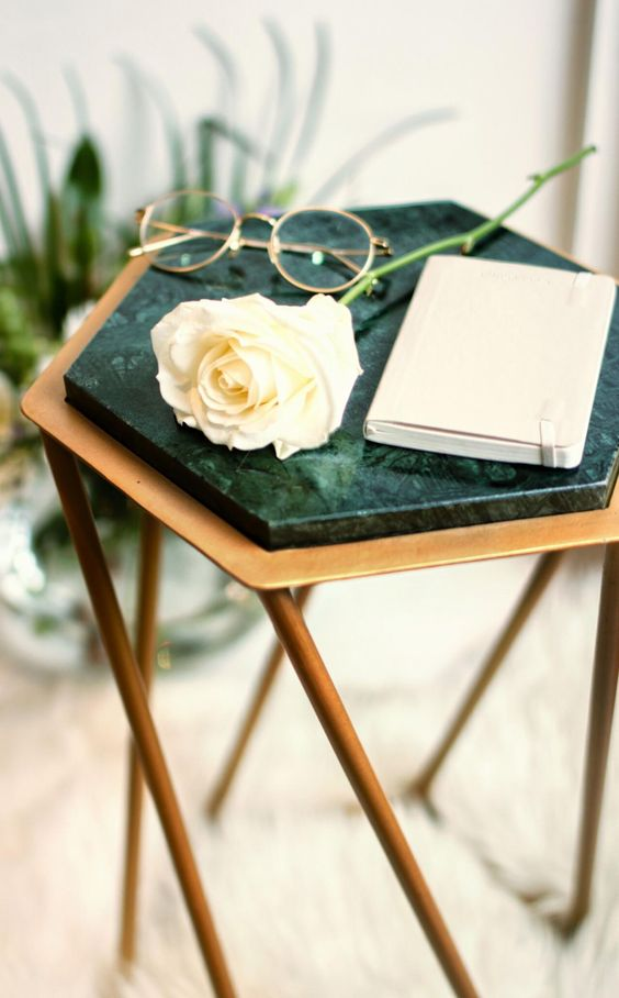 a geometric brass side table with a green marble top looks just wow and makes a refined statement