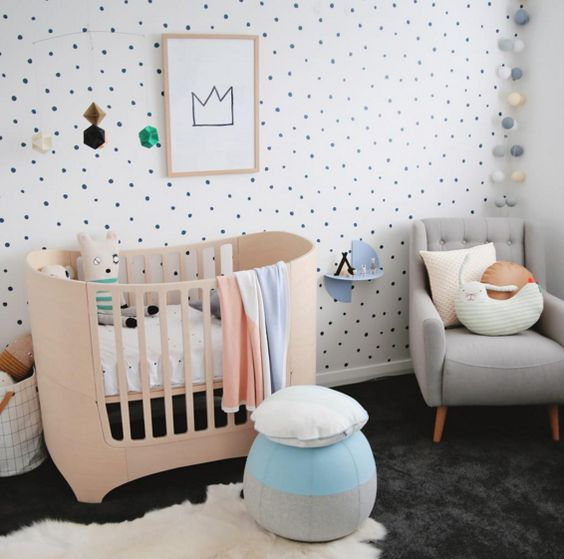 a polka dot wall is the only print here and it adds interest to the space