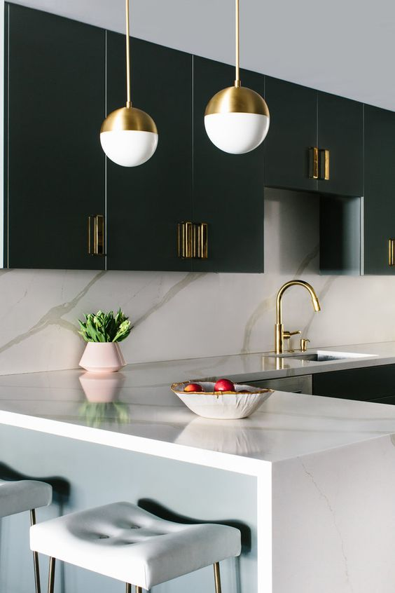 a styligh minimalist kitchen with touches of art deco and chic marble surfaces