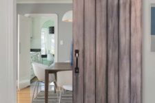 06 this sliding barn door with exposed hardware and studs makes a bold statement in a modern space
