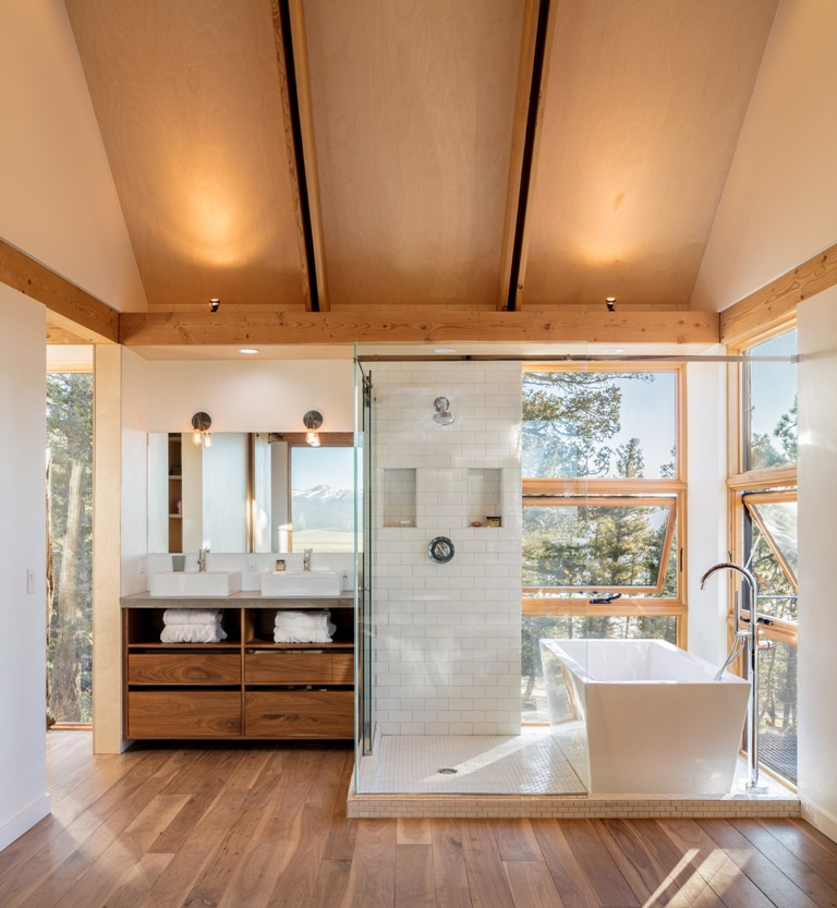 The bathrooms also feature amazing views, and the privacy is kept with the thick forest around the cabins