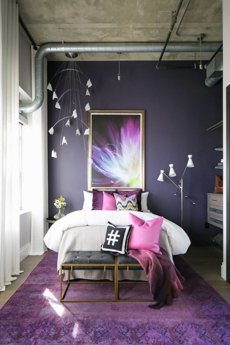 The daughter's bedroom is done in ultra violet, with a floral lamp, a floral artwork and touches of glam