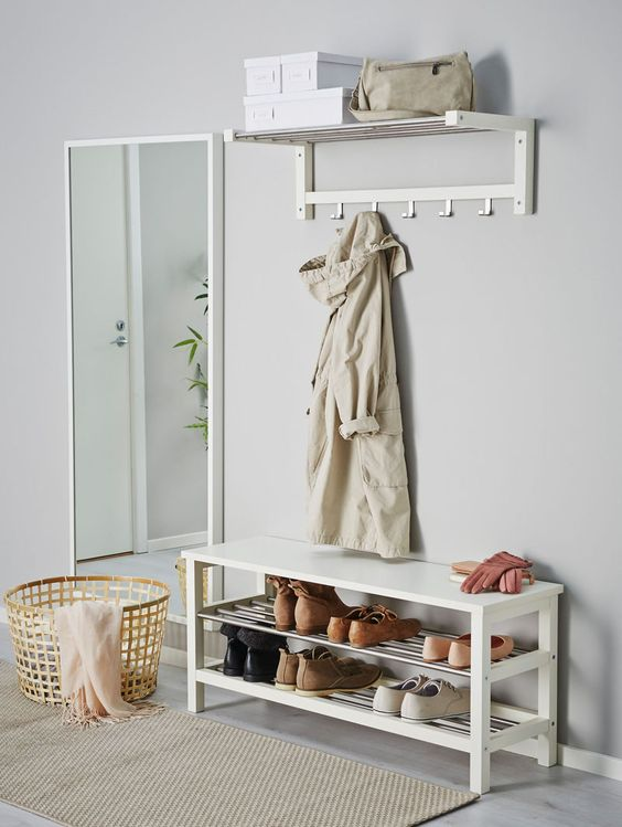 a modern white entryway bench with a double shoe rack is a great ideafor a modern space