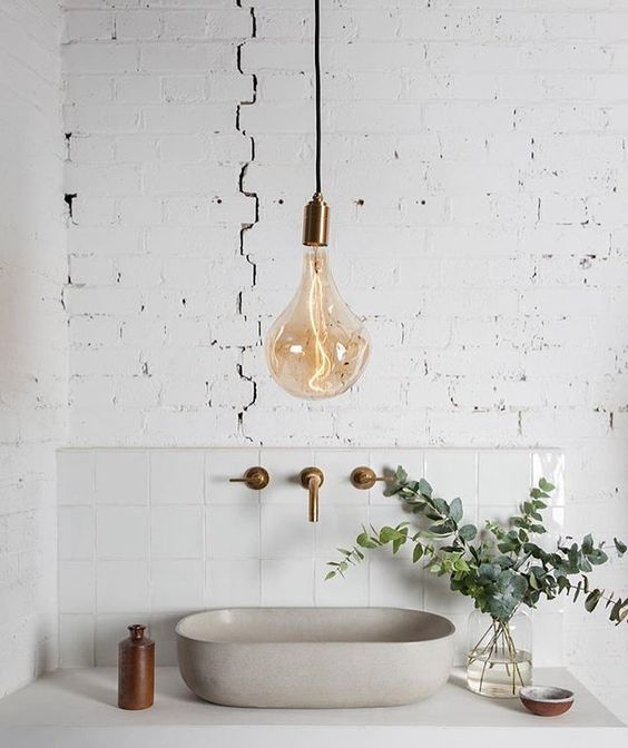 a very cool idea of accent lighting is a large pendant lamp with a brass accent and matching fixtures