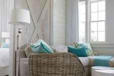 07 a whitewashed barn door is a part of decor and perfectly matches a coastal space