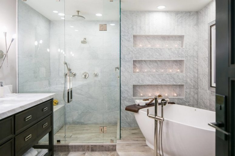 The bathroom is clad with marble tiles, there are niches with candles for taking a bath with comfort
