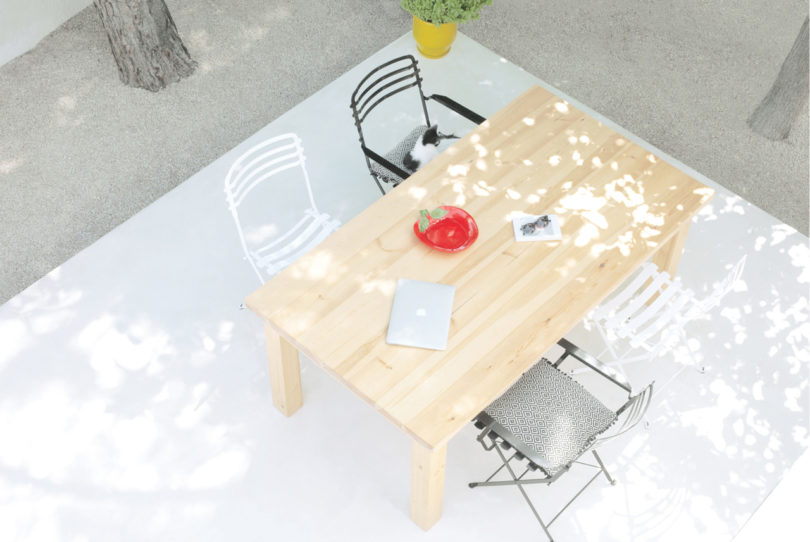 The outdoor terrace features a dining zone with different chairs