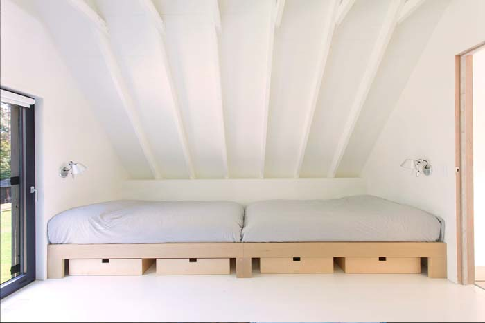 There's an additional sleeping space for guests, with some drawers for storage underneath