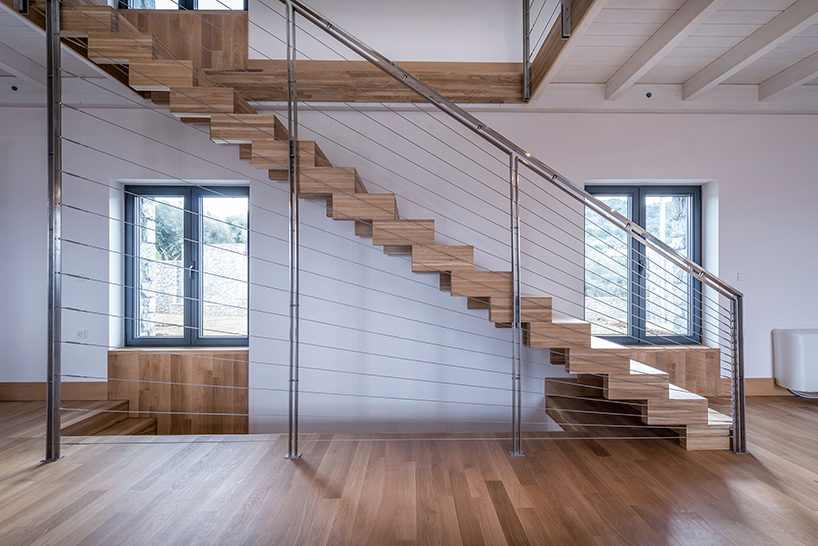 Windows everywhere provide cool views, there's a modern staircase with creative railings