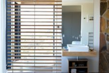 08 a gentle wooden screen separates a bathroom into zones for more privacy and comfort