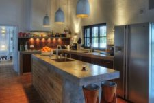 08 an industrial kitchen island of reclaimed wood and a concrete countertop brings much texture and interest