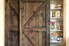 08 hide your built-in pantry with a couple of dark stained barn doors to make the kitchen cozy and welcoming