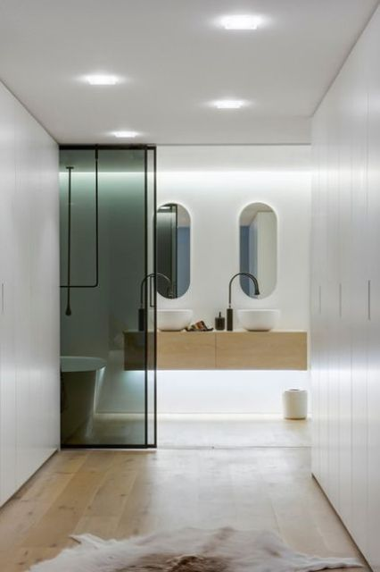 smart, almost invisible ambient lighting and additional built-in accent lighting for a modern space