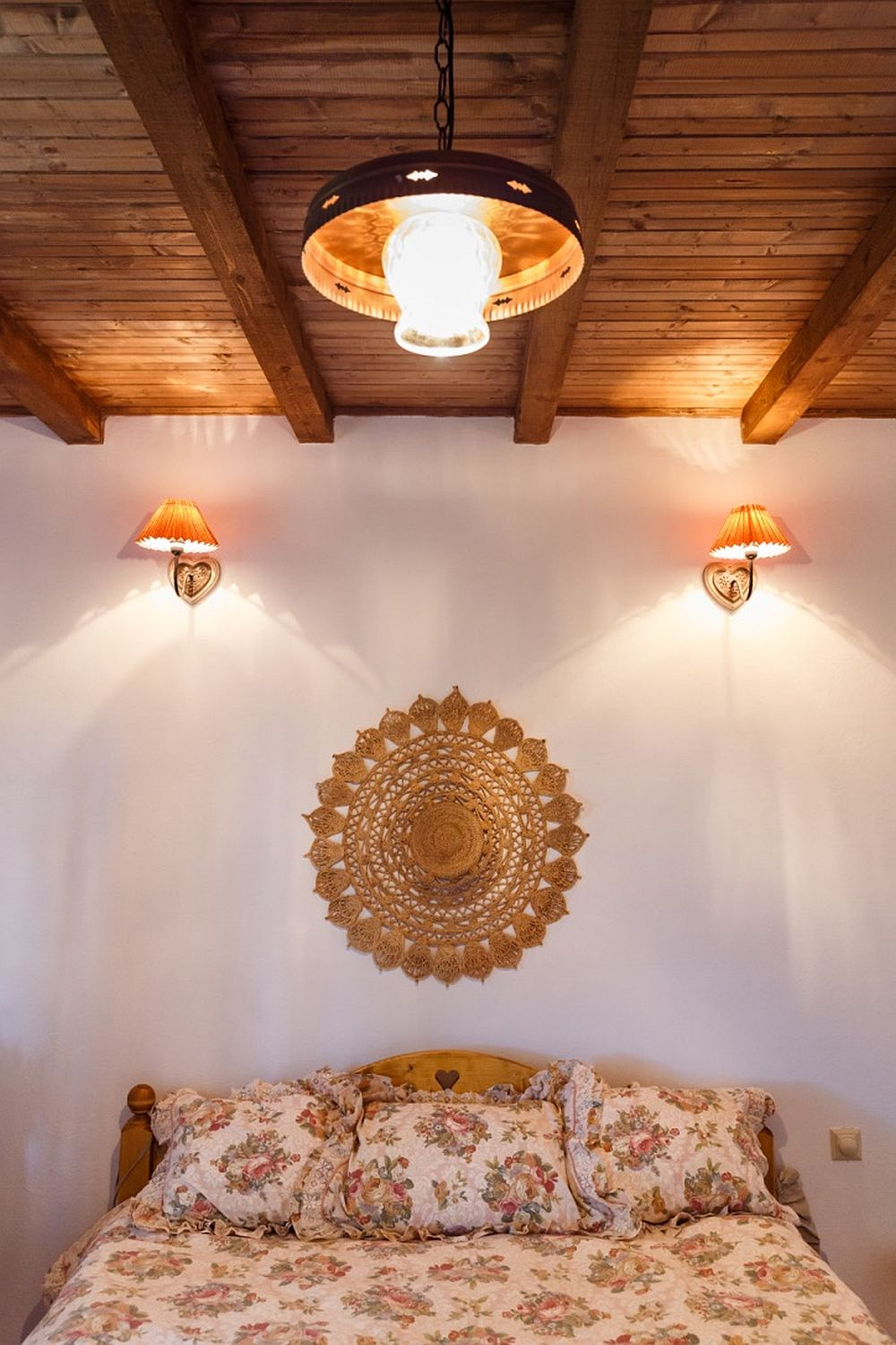 Look at this wooden bed with a carved heart, so cute