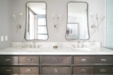 09 You may see a large double vanity, eye-catchy shaped mirrors and creative wall lamps