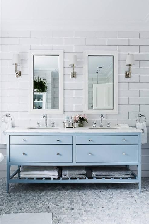 a serenity blue vanity adds a coastal feel to the bathroom and when you are tired of it, you can just repaint it