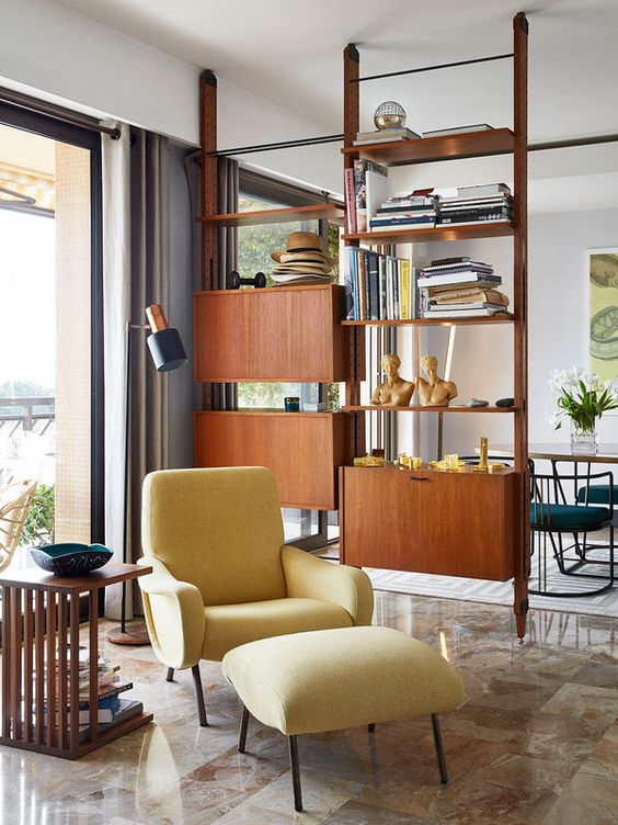 a wooden shelving unit with open shelves and closed cabinets for variative storage perfectly fits a mid-century modern space