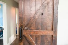 09 add a rustic feel and country charm with rich-colored barn doors to the interiors, even if they aren't very rustic