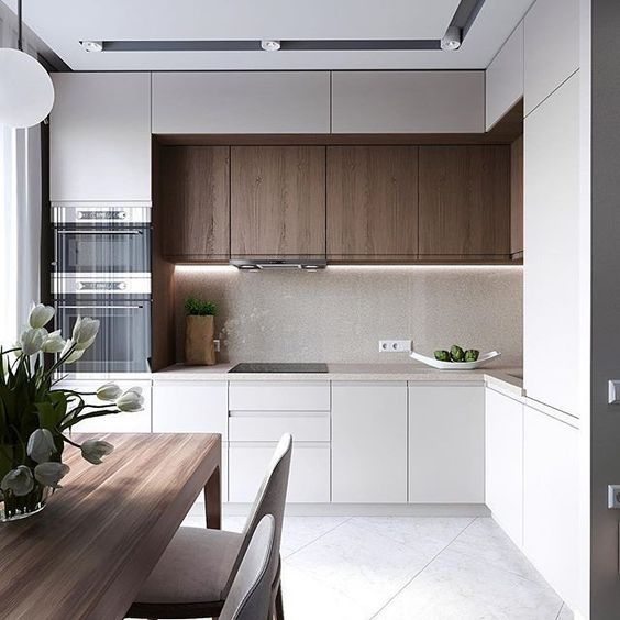 a compact kitchen with minimalist aesthetics and touches of natural wood for more coziness