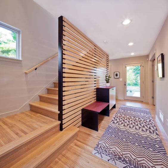 a horizontal wooden plank screen is what you need to avoid a bulky look and make the space airier