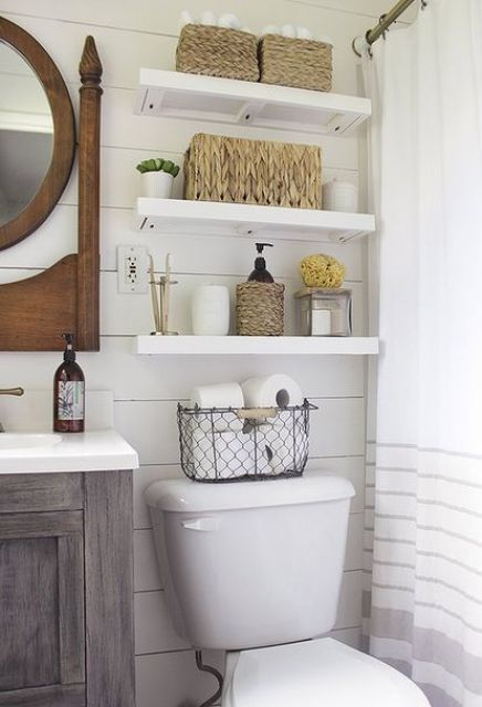 floating shelves over the toilet is timeless classics for a small bathroom, it always works