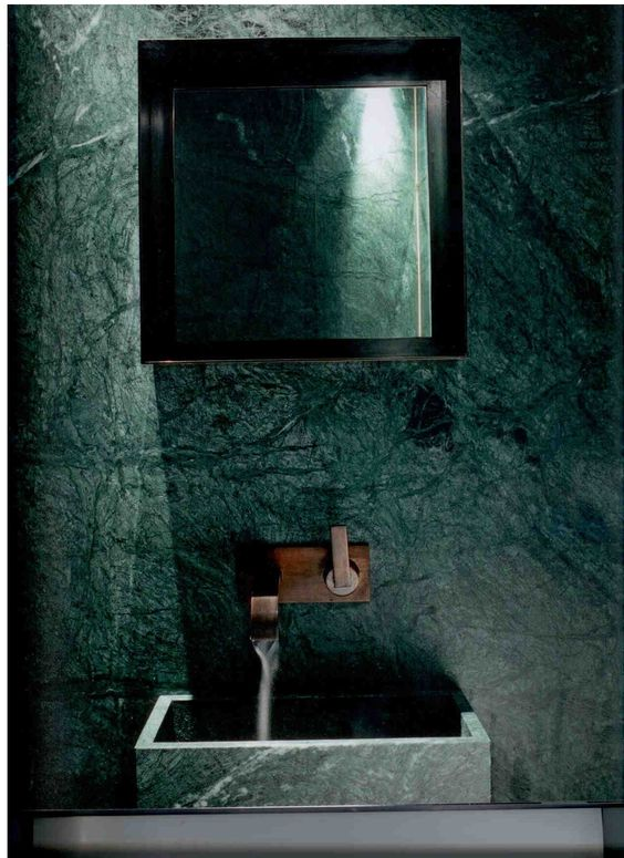 a green marble bathroom wall with a matching sink, a laconic square mirror for a natural yet refined feel