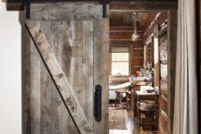 11 a sliding barn door of reclaimed wood is an ideal choice for a woodland or mountain cabin
