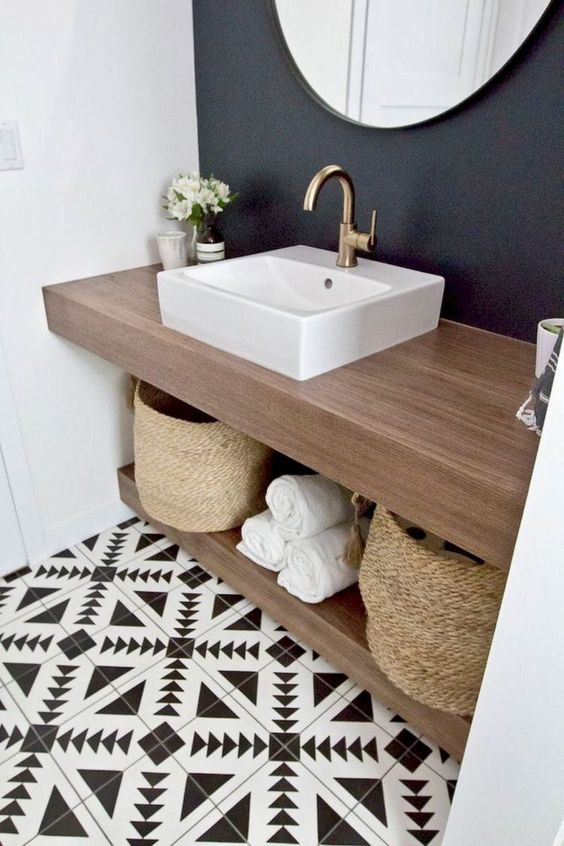 make a double countertop vanity to use the space in between for storage