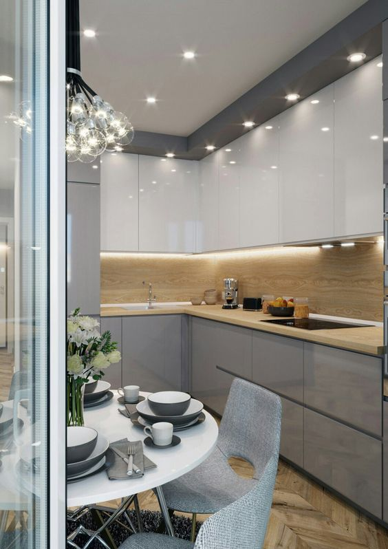 a minimalist kitchen fully illuminated with a large bubble chandelier and some built-in lights