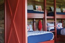 12 a rustic blue and red boys' bedroom and a matching red barn door to highlight the theme
