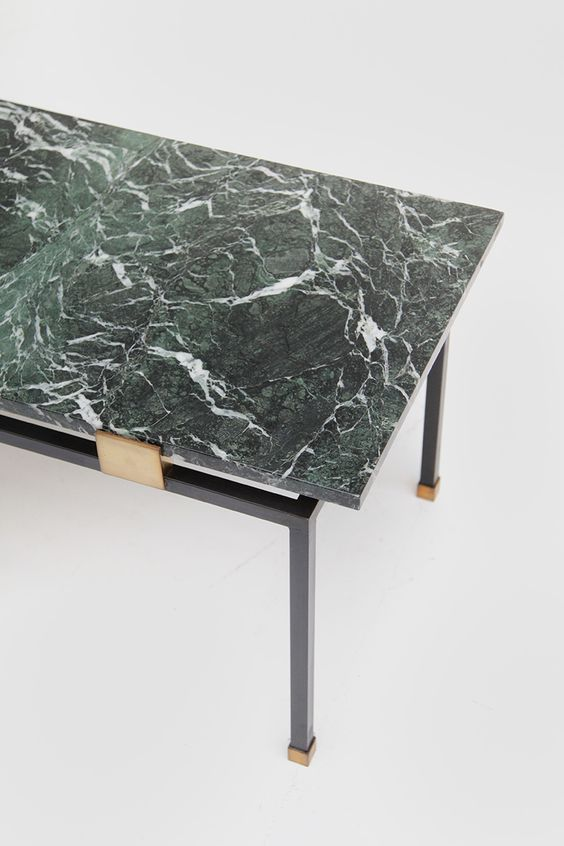 a stylish statement cna be easily made - just buy a coffee table with a green marble top