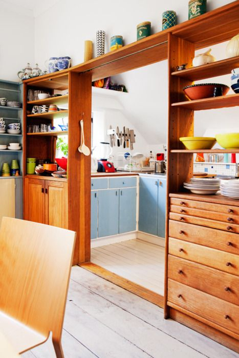 pass-through shelves to separate a kitchen and a dining zone and keep the space open enough yet separated