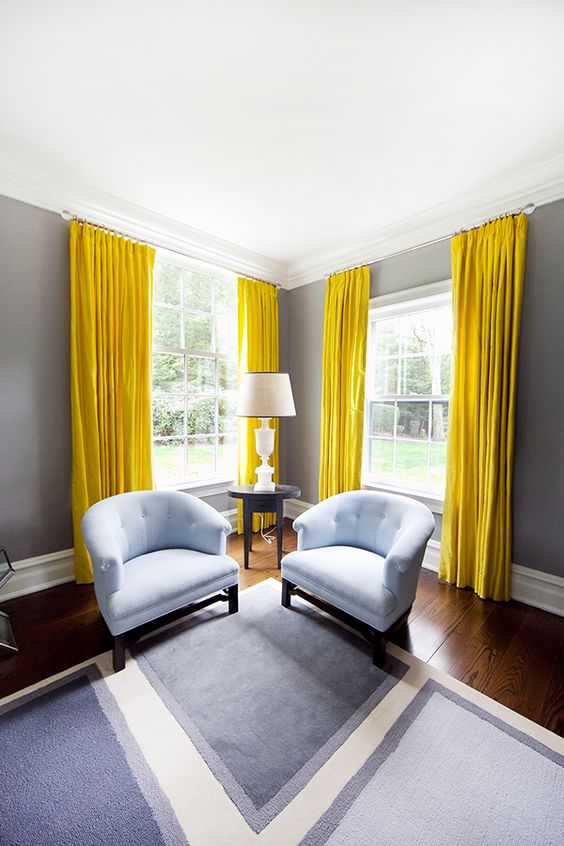 minimalist living room design with yellow curtains