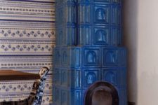 13 Here you'll see another vintage hearth painted bold blue, which adds coziness to the space