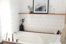 13 a cozy bathroom niche done with white tiles and a bathtub clad with stained wood